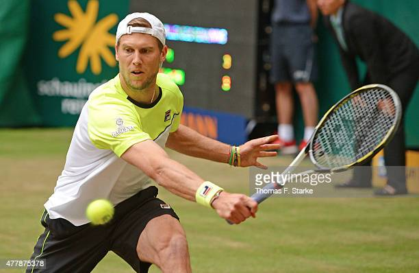 Andreas Seppi of Italy plays a backhand in his match against Kei Nishikori of Japan during day six of the Gerry Weber Open at Gerry Weber Stadium on...