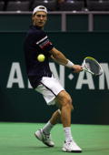 Andreas Seppi of Italy plays a backhand in his match against Stephane Bohli of Switzerland during day one of the ABN AMBRO World Tennis Tournament on...