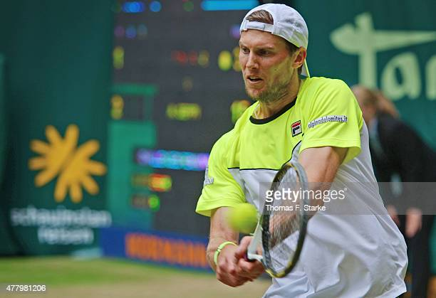 Andreas Seppi of Italy plays a backhand in the final match against Roger Federer of Switzerland during the final day of the Gerry Weber Open at Gerry...