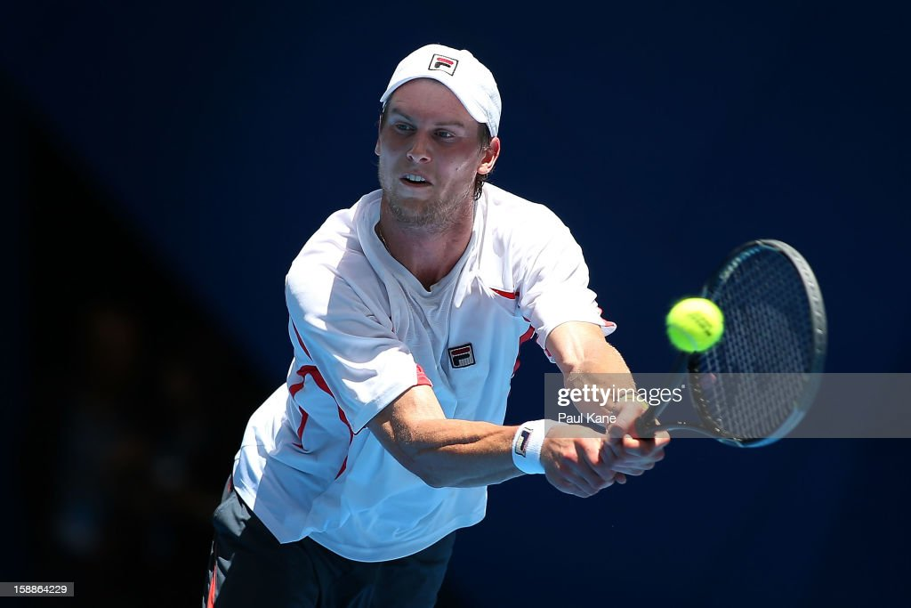 Andreas Seppi of Italy plays a backhand to Tommy Haas of Germany in his singles match during day five of the Hopman Cup at Perth Arena on January 2, 2013 in Perth, Australia.