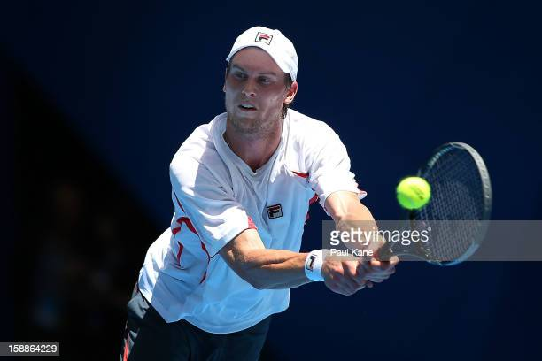 Andreas Seppi of Italy plays a backhand to Tommy Haas of Germany in his singles match during day five of the Hopman Cup at Perth Arena on January 2...