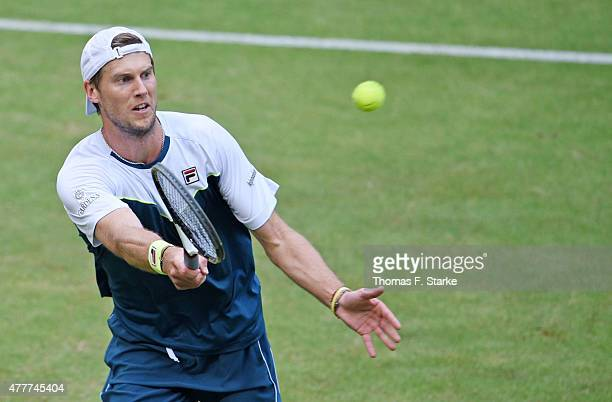 Andreas Seppi of Italy plays a forehand in his match against Gael Monfils of France during day five of the Gerry Weber Open at Gerry Weber Stadium on...