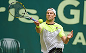 Andreas Seppi of Italy plays a forehand in his match against Kei Nishikori of Japan during day six of the Gerry Weber Open at Gerry Weber Stadium on...