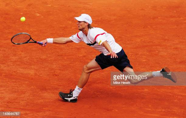 Andreas Seppi of Italy plays a forehand in his men's singles fourth round match against Novak Djokovic of Serbia during day 8 of the French Open at...