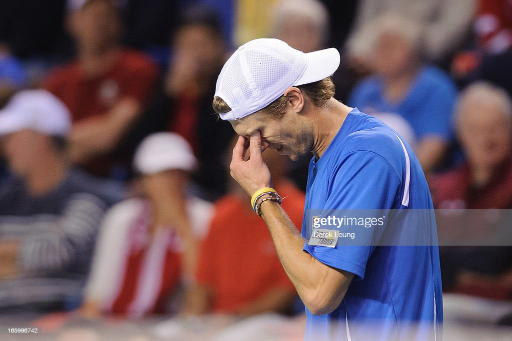 <a gi-track='captionPersonalityLinkClicked' href=/galleries/search?phrase=Andreas+Seppi&family=editorial&specificpeople=228727 ng-click='$event.stopPropagation()'>Andreas Seppi</a> of Italy reacts after losing a game to Milos Raonic of Canada during their singles match on day three of the 2013 Davis Cup quarterfinals on April 7, 2013 at Doug Mitchell Thunderbird Sports Centre in Vancouver, British Columbia, Canada.