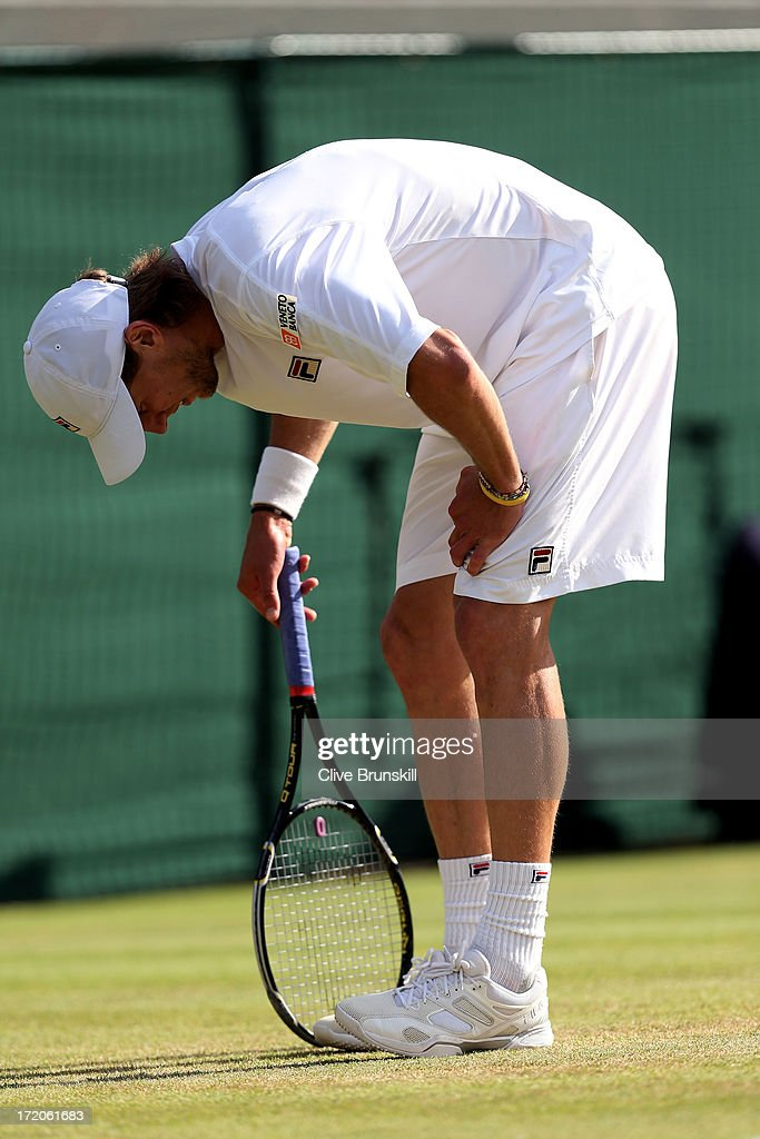 Andreas Seppi of Italy reacts during the Gentlemen's Singles fourth round match against Juan Martin Del Potro of Argentina on day seven of the Wimbledon Lawn Tennis Championships at the All England Lawn Tennis and Croquet Club on July 1, 2013 in London, England.