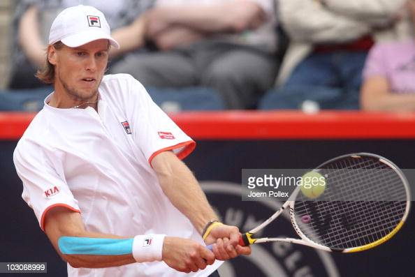 Andreas Seppi of Italy returns a backhand during his Semi Final match against Juergen Melzer of Austria during the International German Open at...