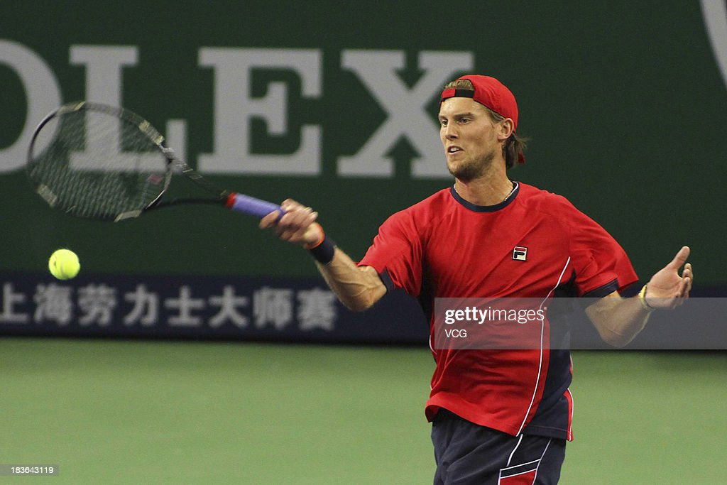 <a gi-track='captionPersonalityLinkClicked' href=/galleries/search?phrase=Andreas+Seppi&family=editorial&specificpeople=228727 ng-click='$event.stopPropagation()'>Andreas Seppi</a> of Italy returns a ball to Lleyton Hewitt of Australia on day two of the Shanghai Rolex Masters at the Qi Zhong Tennis Center on October 8, 2013 in Shanghai, China.