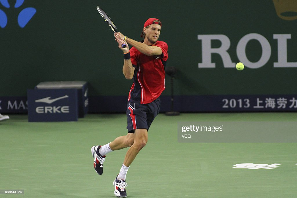 Andreas Seppi of Italy returns a ball to Lleyton Hewitt of Australia on day two of the Shanghai Rolex Masters at the Qi Zhong Tennis Center on October 8, 2013 in Shanghai, China.