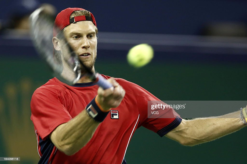 Andreas Seppi of Italy returns a ball to Roger Federer of Switzerland on day three of the Shanghai Rolex Masters at the Qi Zhong Tennis Center on October 9, 2013 in Shanghai, China.