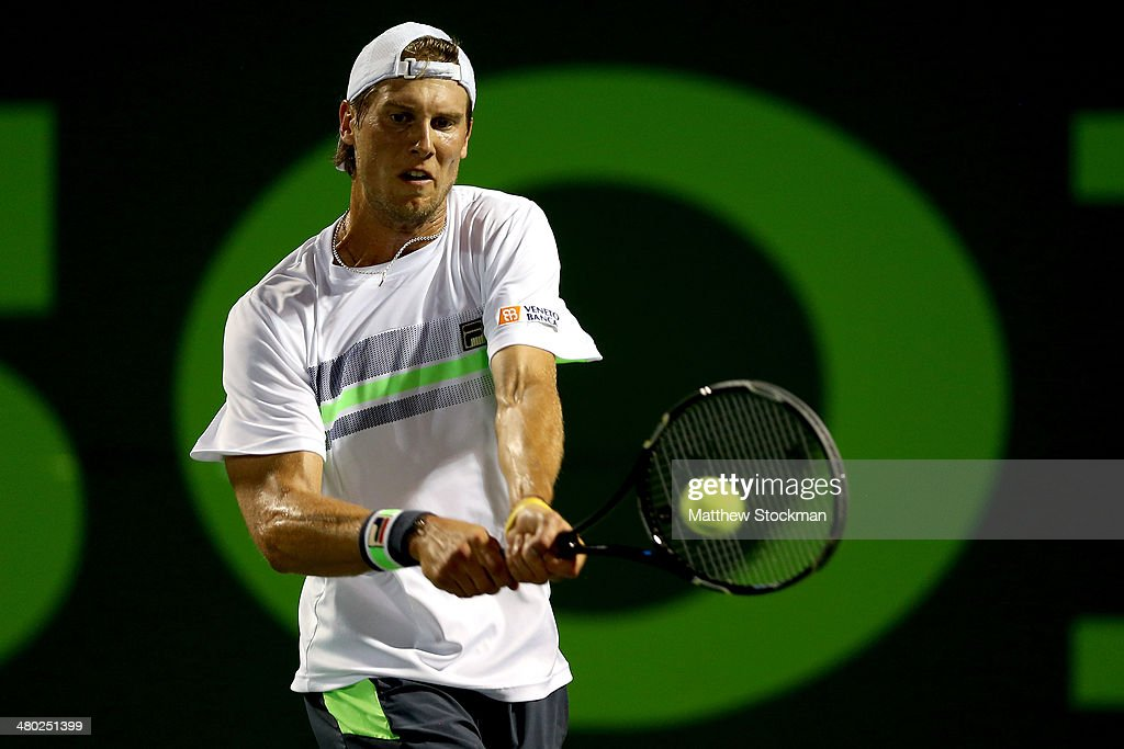 Andreas Seppi of Italy returns a shot to David Ferrer of Spain during the Sony Open at the Crandon Park Tennis Center on March 23, 2014 in Key Biscayne, Florida.