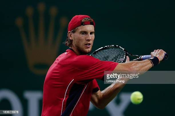 Andreas Seppi of Italy returns a shot to Lleyton Hewitt of Australia during day two of the Shanghai Rolex Masters at the Qi Zhong Tennis Center on...