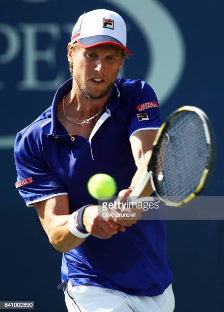 Andreas Seppi of Italy returns a shot to Roberto Bautista Agut of Spain during their first round Men's Singles match on Day Three of the 2017 US Open...
