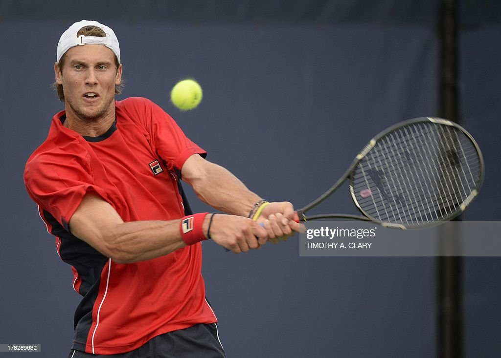 Andreas Seppi of Italy returns against Xavier Malisse of Belgium during their 2013 US Open singles match at the USTA Billie Jean King National Tennis Center in New York on August 28, 2013.