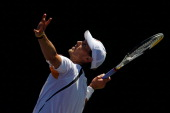 Andreas Seppi of Italy serves against Alexandr Dolgopolov of the Ukraine during the Sony Ericsson Open at Crandon Park Tennis Center on March 26 2011...