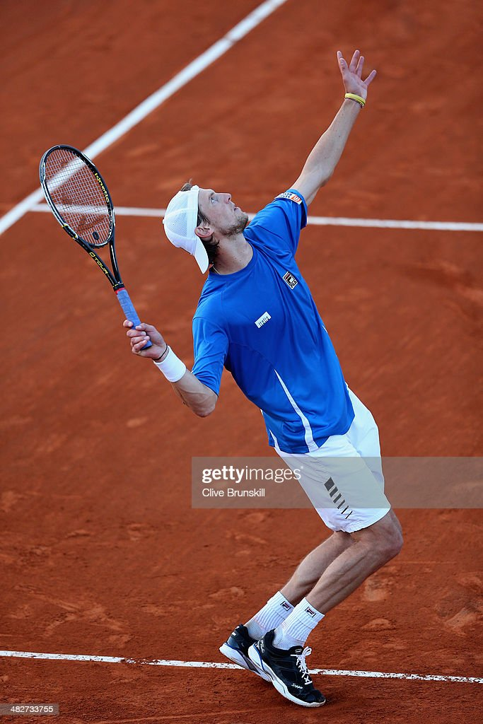 Andreas Seppi of Italy serves against Andy Murray of Great Britain during day one of the Davis Cup World Group Quarter Final match between Italy and Great Britain at Tennis Club Napoli on April 4, 2014 in Naples, Italy.