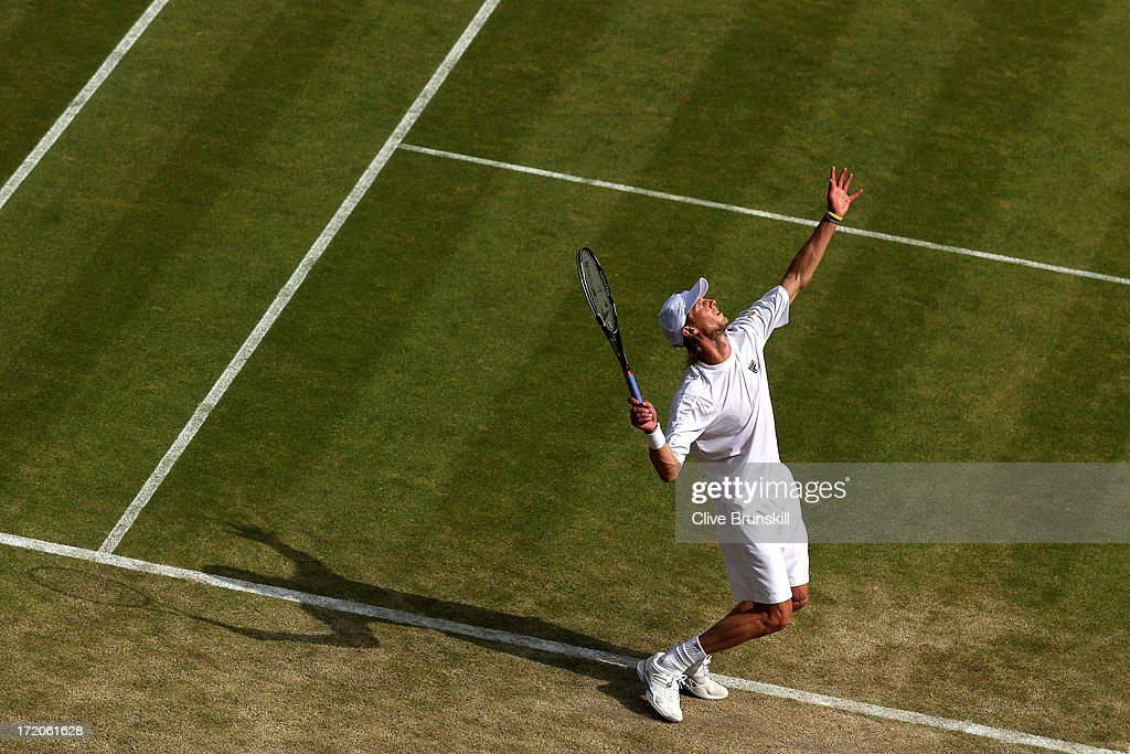 Andreas Seppi of Italy serves during the Gentlemen's Singles fourth round match against Juan Martin Del Potro of Argentina on day seven of the Wimbledon Lawn Tennis Championships at the All England Lawn Tennis and Croquet Club on July 1, 2013 in London, England.