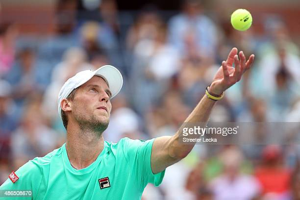 Andreas Seppi of Italy serves to Novak Djokovic of Serbia during their Men's Singles Third Round match on Day Five of the 2015 US Open at the USTA...