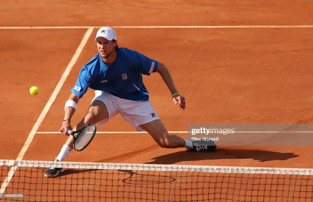 <a gi-track='captionPersonalityLinkClicked' href=/galleries/search?phrase=Andreas+Seppi&family=editorial&specificpeople=228727 ng-click='$event.stopPropagation()'>Andreas Seppi</a> of Italy slides to play a forehand volley during the fifth and decisive rubber against James Ward of Great Britain during day three of the Davis Cup World Group Quarter Final match between Italy and Great Britain at Tennis Club Napoli on April 6, 2014 in Naples, Italy.
