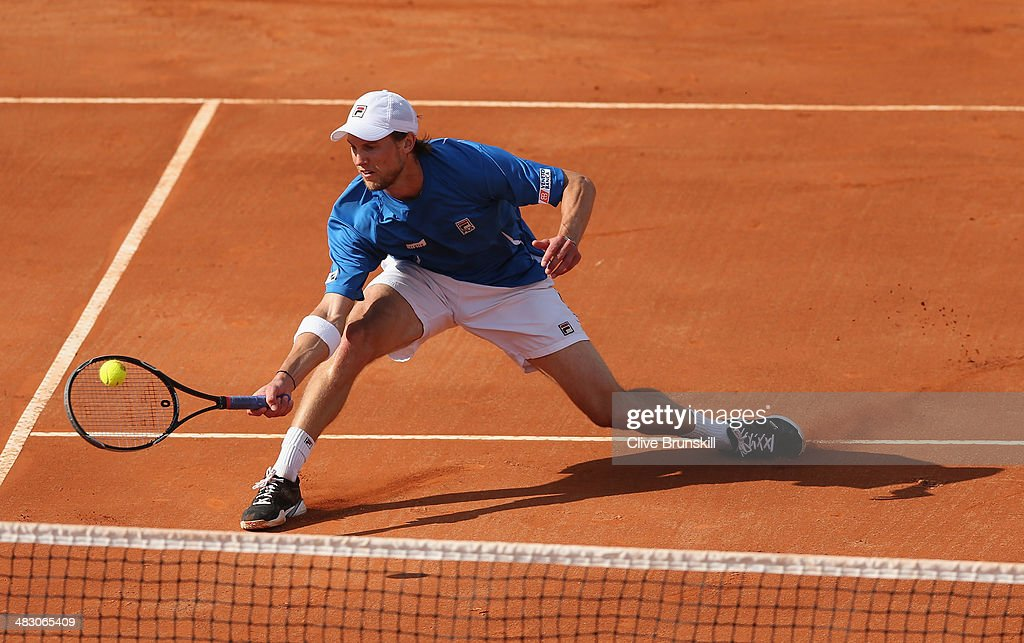 Andreas Seppi of Italy slides to play a forehand volley during the fifth and decisive rubber against James Ward of Great Britain during day three of the Davis Cup World Group Quarter Final match between Italy and Great Britain at Tennis Club Napoli on April 6, 2014 in Naples, Italy.
