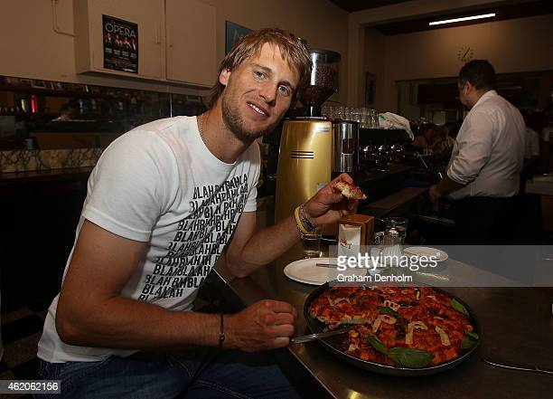 Andreas Seppi of Italy smiles as he visits Italian cafe Pellegrini's during the 2015 Australian Open at Melbourne Park on January 24 2015 in...