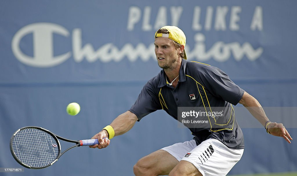 Andreas Seppi of Italy stretches to return the ball against Steve Johnson on August 20, 2013 in Winston Salem, North Carolina.