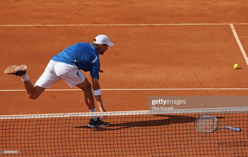 Andreas Seppi of Italy throws his racket to the ball after missing a backhand volley during the fifth and decisive rubber against James Ward of Great Britain during day three of the Davis Cup World Group Quarter Final match between Italy and Great Britain at Tennis Club Napoli on April 6, 2014 in Naples, Italy.