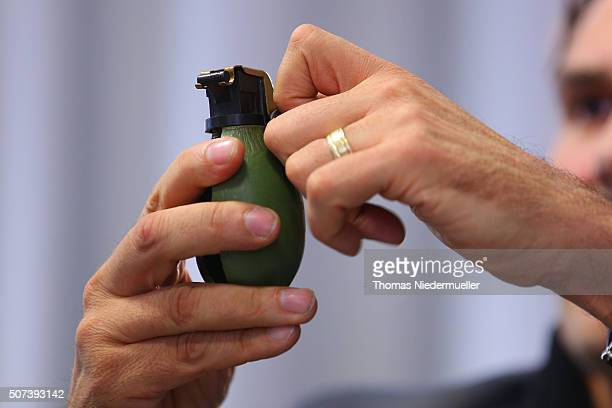 Andreas Stenger of State Office of Criminal Investigation shows a M52 hand granade at a press conferece after an unknown assailant threw a live hand...
