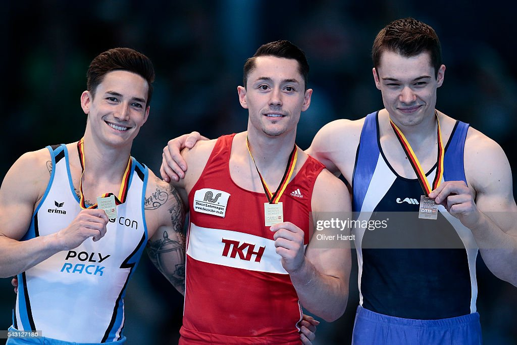 Andreas Toba (C) with first place and <a gi-track='captionPersonalityLinkClicked' href=/galleries/search?phrase=Marcel+Nguyen&family=editorial&specificpeople=241408 ng-click='$event.stopPropagation()'>Marcel Nguyen</a> (L) and Florian Lindner (R) of Germany pose with their medals after winning the German Gymnastics Championship Day 2 at Sporthalle Hamburg on June 26, 2016 in Hamburg, Germany.