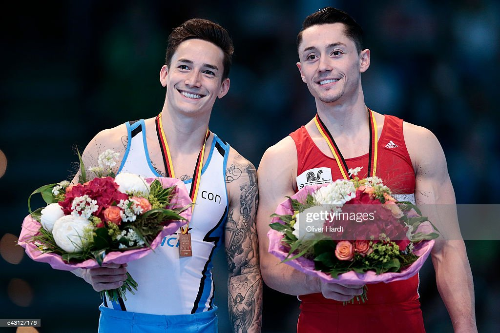 Andreas Toba (R) with first place and <a gi-track='captionPersonalityLinkClicked' href=/galleries/search?phrase=Marcel+Nguyen&family=editorial&specificpeople=241408 ng-click='$event.stopPropagation()'>Marcel Nguyen</a> (L) of Germany pose with their medals after winning the German Gymnastics Championship Day 2 at Sporthalle Hamburg on June 26, 2016 in Hamburg, Germany.