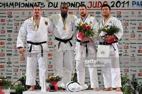 Andreas Toelzer of Germany with the silver medal fivetime world champion Teddy Riner of France with the gold medal Alexander Mikhaylin of Russia and...