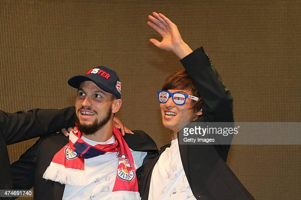 Andreas Ulmer and Takumi Minamino of Salzburg celebrate with the trophy for winning the Austrian Soccer Championship after the tipico Bundesliga...