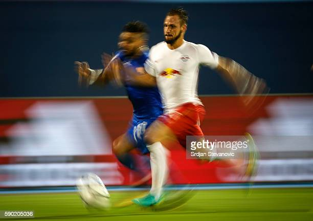 Andreas Ulmer of Salzburg competes for the ball against El Arabi Hilal Soudani of Dinamo Zagreb during the UEFA Champions League Playoffs First leg...