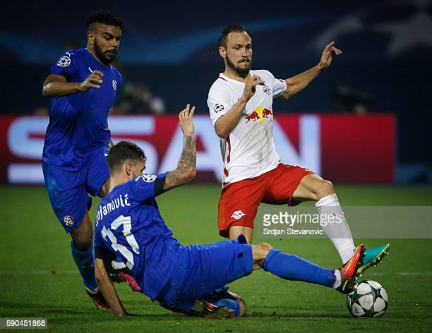 Andreas Ulmer of Salzburg is challenged by Petar Stojanovic and El Arabi Hilal Soudani of Dinamo Zagreb looks on during the UEFA Champions League...
