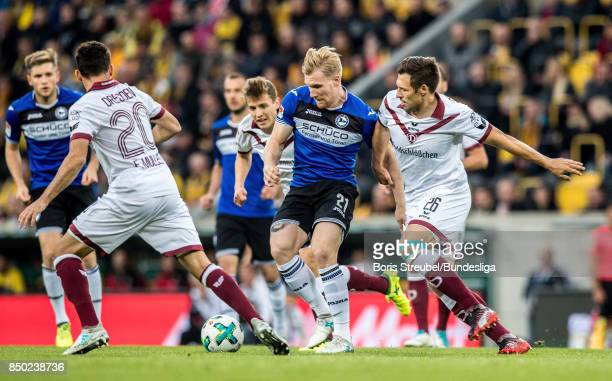 Andreas Voglsammer of Arminia Bielefeld in action with Sören Gonther of SG DYnamo Dresden and Fabian Mueller of SG DYnamo Dresden during the Second...