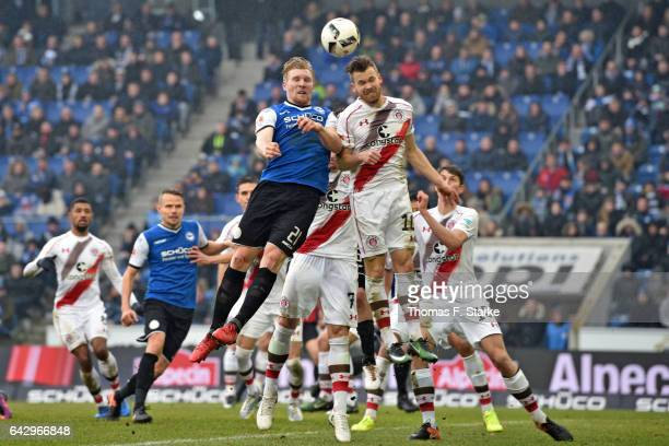 Andreas Voglsammer of Bielefeld and Christopher Buchtmann of St Pauli head for the ball during the Second Bundesliga match between DSC Arminia...