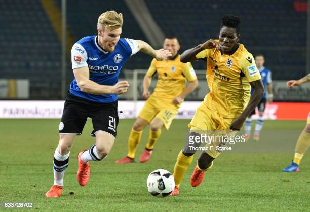Andreas Voglsammer of Bielefeld and Lumor of Munich fight for the ball during the Second Bundesliga match between DSC Arminia Bielefeld and TSV 1860...