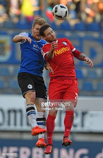 Andreas Voglsammer of Bielefeld and Timo Perthel of Bochum head for the ball during the Second Bundesliga match between DSC Arminia Bielefeld and VfL...