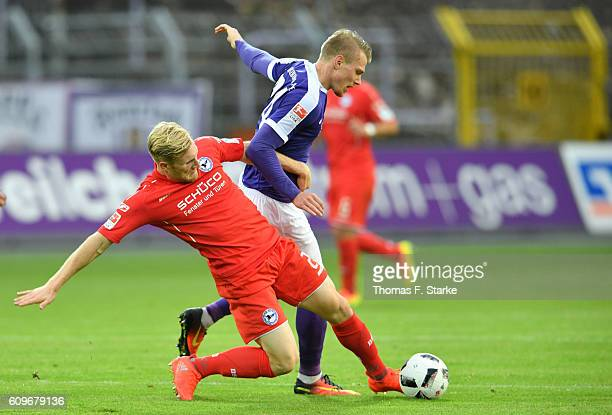 Andreas Voglsammer of Bielefeld tackles Steve Breitkreuz of Aue during the Second Bundesliga match between FC Erzgebirge Aue and DSC Arminia...