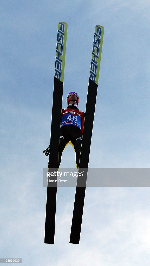 Andreas Wank of Germany competes during the trial round for the FIS Ski Jumping World Cup event of the 61st Four Hills ski jumping tournament at Olympiaschanze on December 31, 2012 in Garmisch-Partenkirchen, Germany.