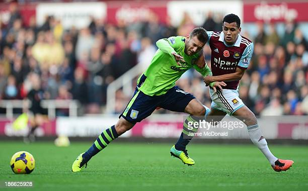 Andreas Weimann of Aston Villa challenges for the ball with Ravel Morrison of West Ham United during the Barclays Premier League match between West...