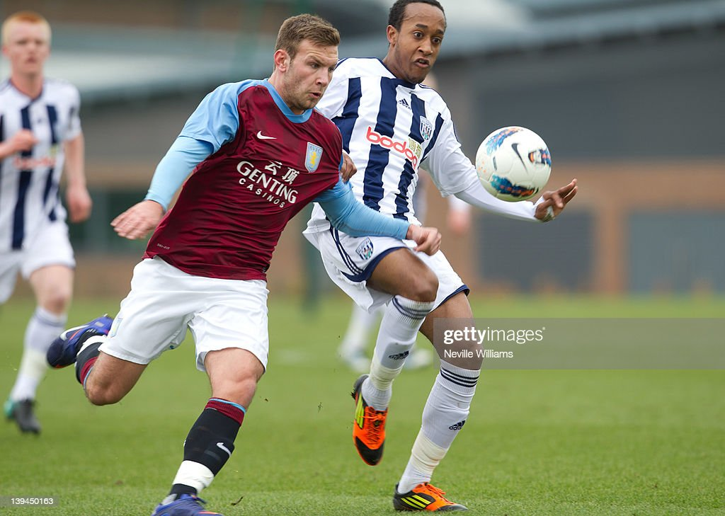 Andreas Weimann of Aston Villa is challenged by Kemar Roofe of West Bromwich Albion during the Barclays Premier Reserve League match between Aston Villa Reserves and West Bromwich Albion Reserves at the club's training ground at Bodymoor Heath on February 21, 2012 in Birmingham, England.