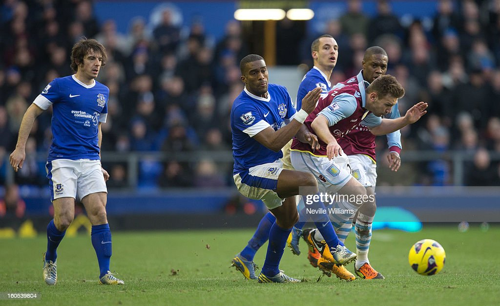 Andreas Weimann of Aston Villa is challenged by Sylvain Distin of Everton during the Barclays Premier League match between Everton and Aston Villa at Goodison Park on February 02, 2013 in Liverpool, England.