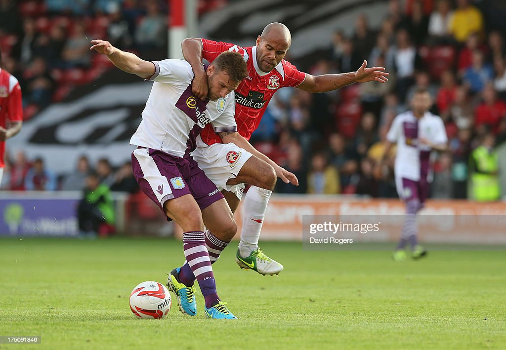 <a gi-track='captionPersonalityLinkClicked' href=/galleries/search?phrase=Andreas+Weimann&family=editorial&specificpeople=5891558 ng-click='$event.stopPropagation()'>Andreas Weimann</a> of Aston Villa is held by <a gi-track='captionPersonalityLinkClicked' href=/galleries/search?phrase=Adam+Chambers&family=editorial&specificpeople=3122074 ng-click='$event.stopPropagation()'>Adam Chambers</a> during the pre season friendly match between Walsall Town and Aston Villa at the Banks' Stadium on July 31, 2013 in Walsall, England.