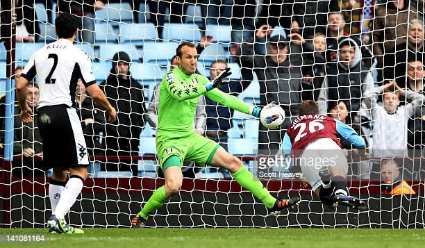 Andreas Weimann of Aston Villa scors their winning goal past Mark Schwarzer of Fulham during the Barclays Premier League match between Aston Villa...