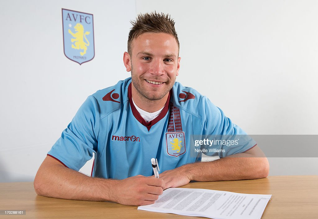 Andreas Weimann of Aston Villa signs a new contract at the club's training ground at Bodymoor Heath on June 10, 2013 in Birmingham, England.