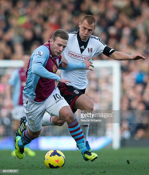 Andreas Weimann of AstonVilla is challenged by Steve Sidwell of Fulham during the Barclays Premier League match between Fulham and Aston Villa at...