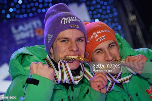 Andreas Wellinger and Markus Eisenbichler of Germany celebrate with their medals after victory in the Mixed Team HS100 Normal Hill Ski Jumping during...