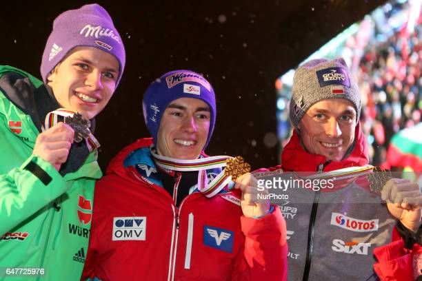 Andreas Wellinger from Germany Stefan Kraft from Austria and Piotr Zyla from Poland the podium of Men Large Hill Individual final in ski jumping at...