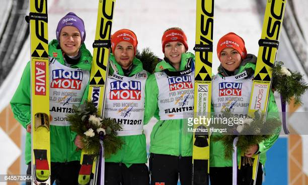 Andreas Wellinger Markus Eisenbichler Svenja Wuerth and Carina Vogt of Germany celebrate their gold medal in the Mixed Team HS100 Normal Hill Ski...